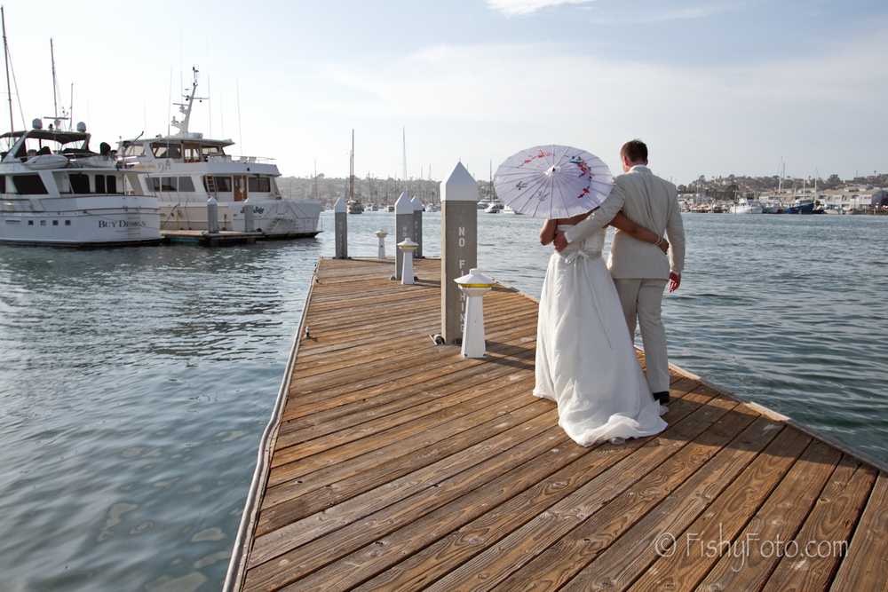 Bride and Groom take couple shots at the marina.  #FishyFoto