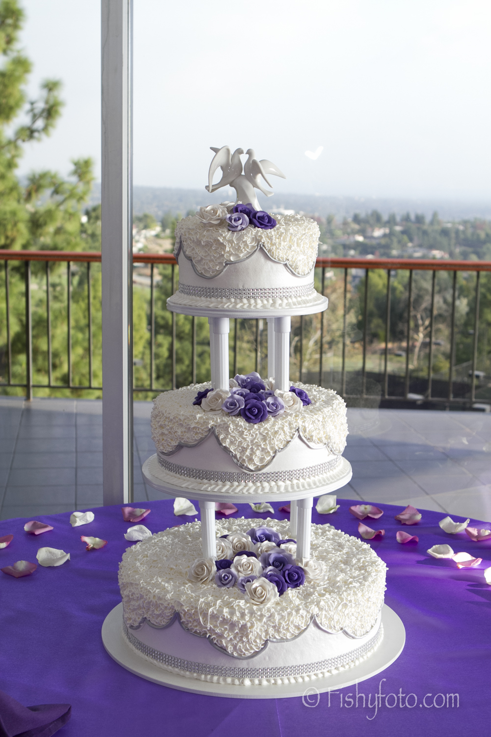 Three tiered cake at a wedding.  #FishyFoto