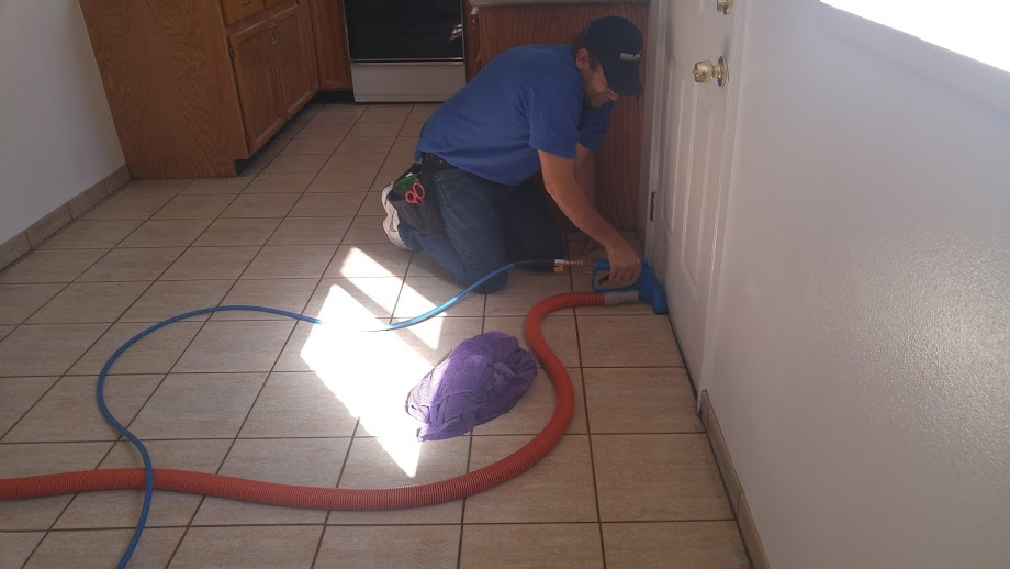 using a hand tool to clean the tile and grout in Utah County.jpg