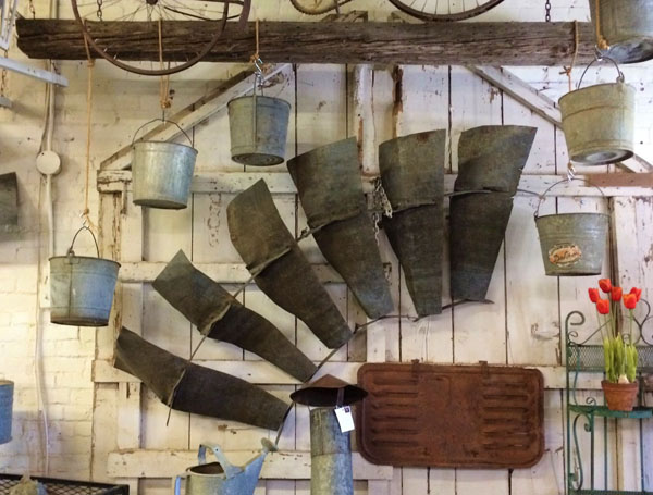 Windmill blades, ceiling tins, architectural pieces, miscellaneous auto parts, water pails - it all can look like art when it is displayed well.