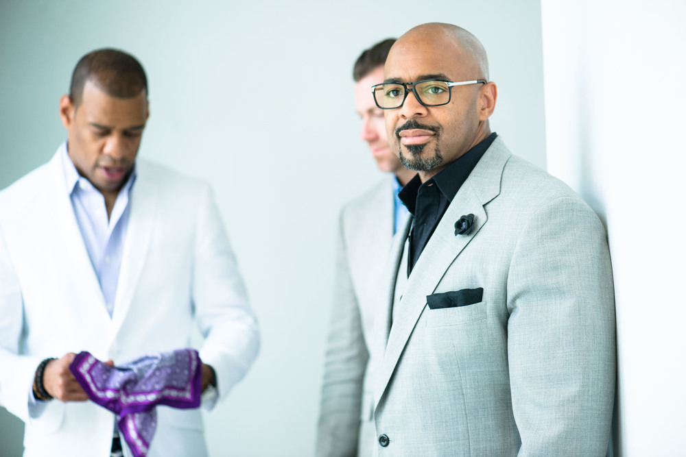 Demarco morgan, greg camp, and kofi smith gearing up for the second delivery photo shoot for bloomingdale's men of style. Photographed by galina coada.
