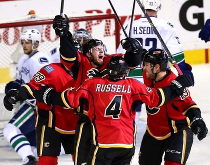 The Calgary Flames celebrate after Matt Stajan scores, taking the Flames into the lead over the Vancouver Canucks. Photo credit: Calgary Sun