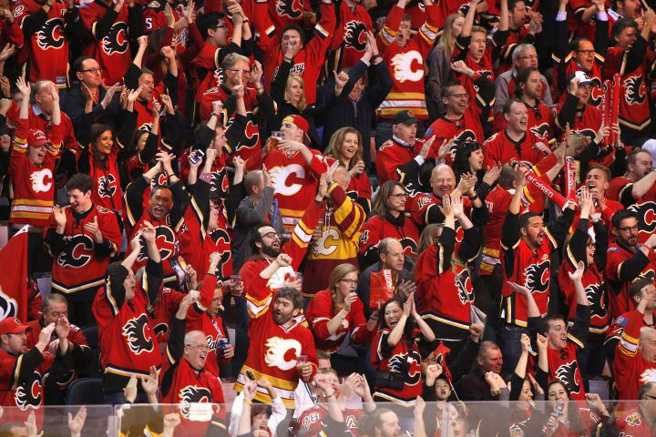 Calgary Flames fans cheer at the Scotiabank Saddledome. Photo Credit: Global Calgary