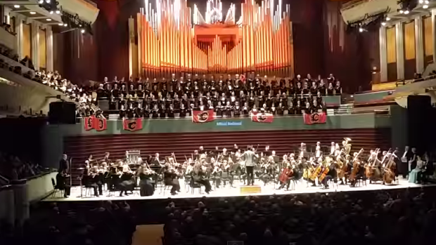 "The Calgary Philharmonic Orchestra (cpo) and the CPo Choir delights their audience with a special version of Carl Off's ""O Fortuna"", in honour of the Calgary Flames' win over the vancouver canucks. Photo credit: CPO"