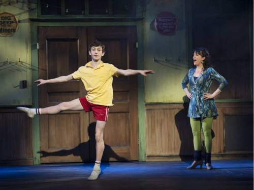 Fahey performs a series of grand pirouettes in second position as Mrs. Wilkinson (Caitriona Murphy) instructs him.