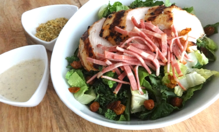 The Policia Fashionista: grilled chicken, oven roasted turkey back bacon, tossed in romaine and kale, with creamy, dairy free Caesar dressing, turmeric spiced crispy chickpea croutons, and walnut-hemp parmesanm