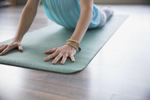 woman-practicing-yoga-in-cobra-pose-536906941-573b1ea43df78c6bb05d2009.jpg