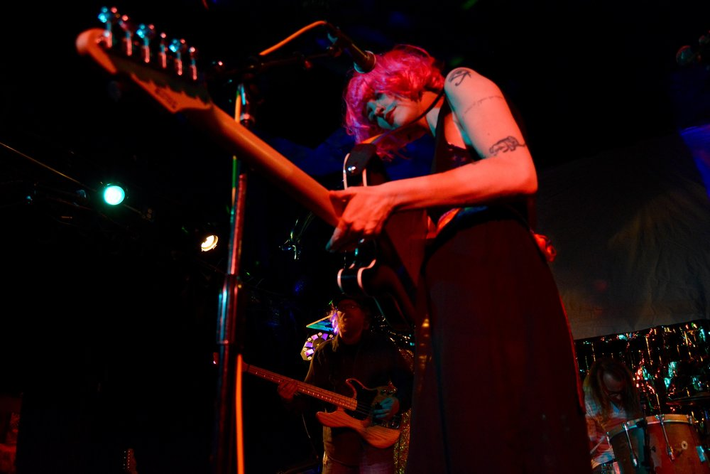 Esme Patterson dragging strings across mic stand.jpg