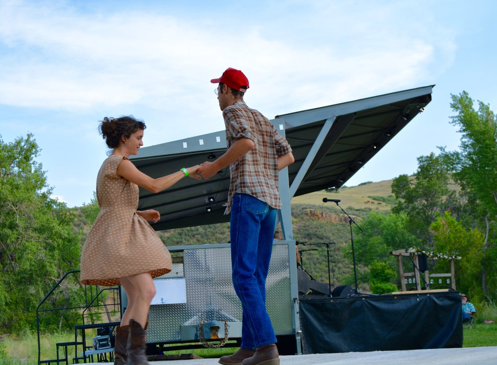 Aviva Steigmeyer & Roy Pilgrim of the Ozark Highballers join in on the festival dancing.