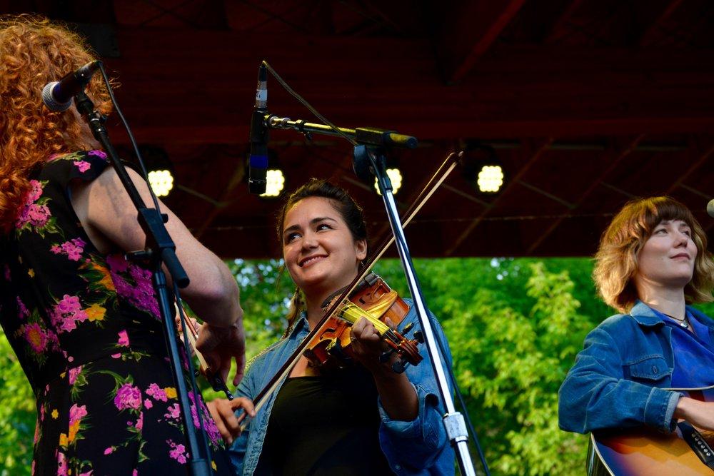 Becky Buller plays twin fiddles with a guest fiddler _ Molly Tuttle.jpg