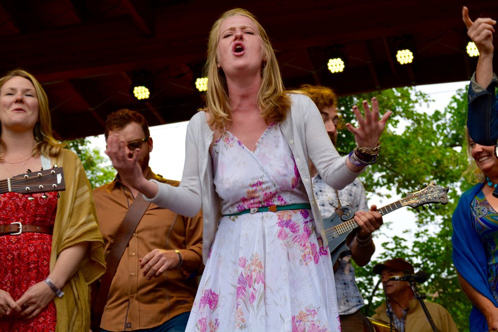 Bonnie Sims with Lyons Bluegrass Collective helping lead the sing-along.jpg