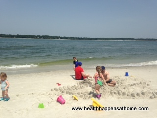 my kids building sandcastles with daddy and uncle