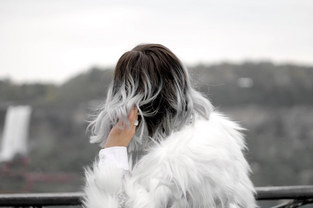 Bratty B posing in faux fur in front of Niagara Falls, ON Canada taken by Elaisha Jade