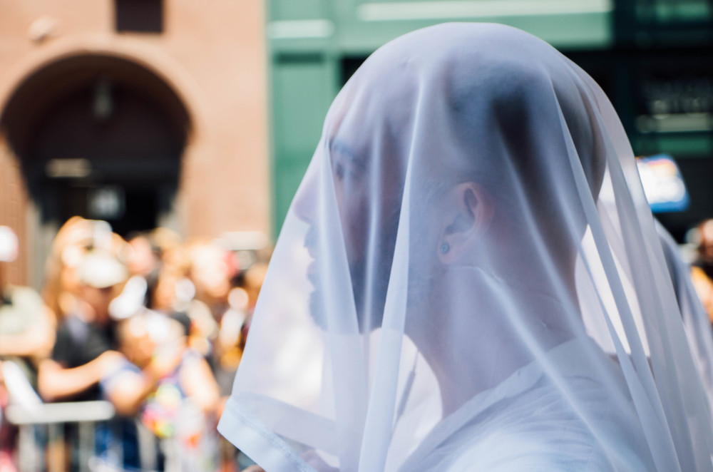 One group dressed in all white with veils covering their faces.