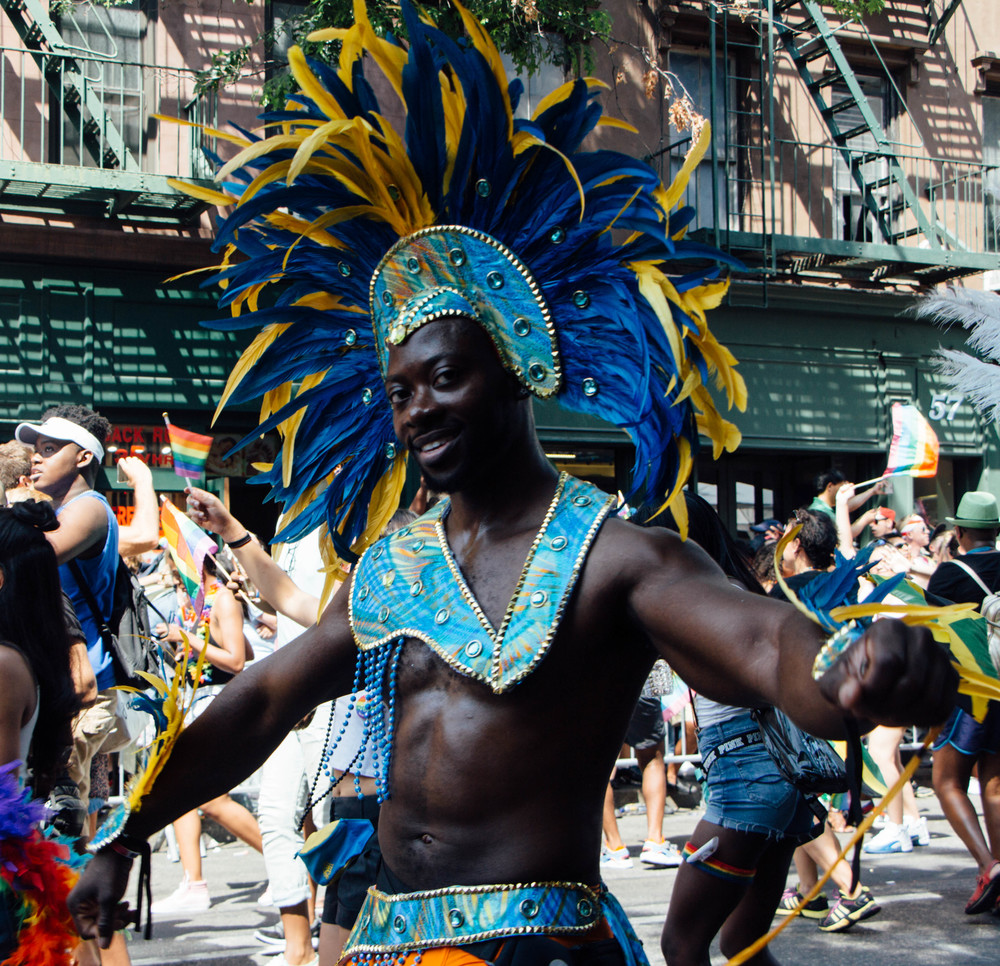 A group dressed in Caribbean garb shows support to the LGBTQ community.