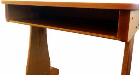Cubby storage space in single adj. desk leg