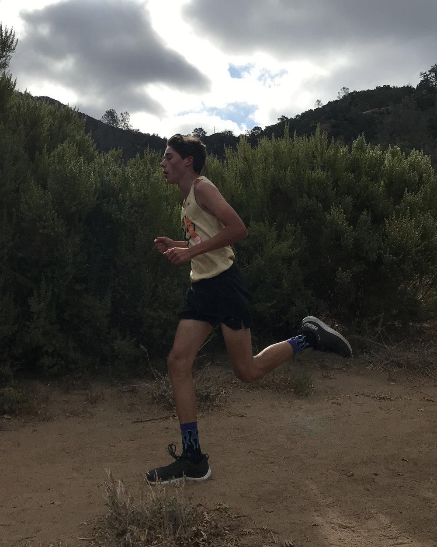 Dylan Reiss running a cross country race.