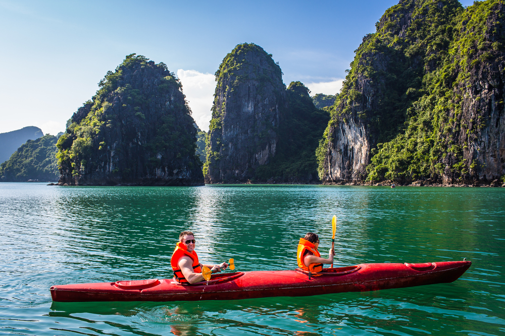 Kết quả hình ảnh cho Paddle Kayak boat on your own to contemplate Halong Bay