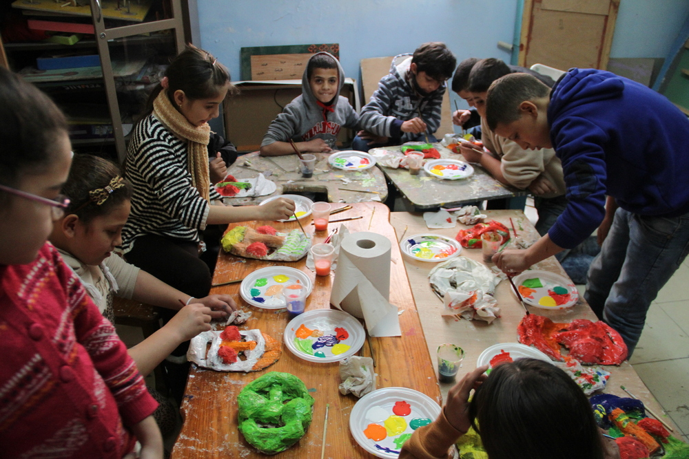 Painting paper mache masks at Aida Refugee Camp in West Bank, Palestine