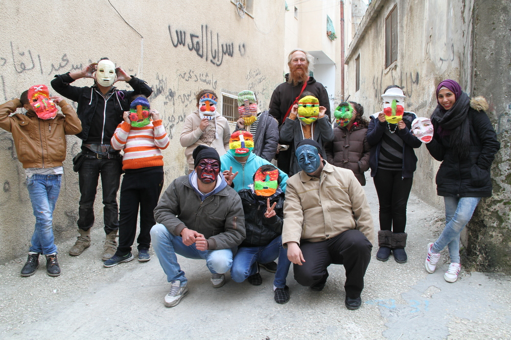 Proud young artists with their masks from a workshop at the Aida refugee camp in West Bank, Palestine