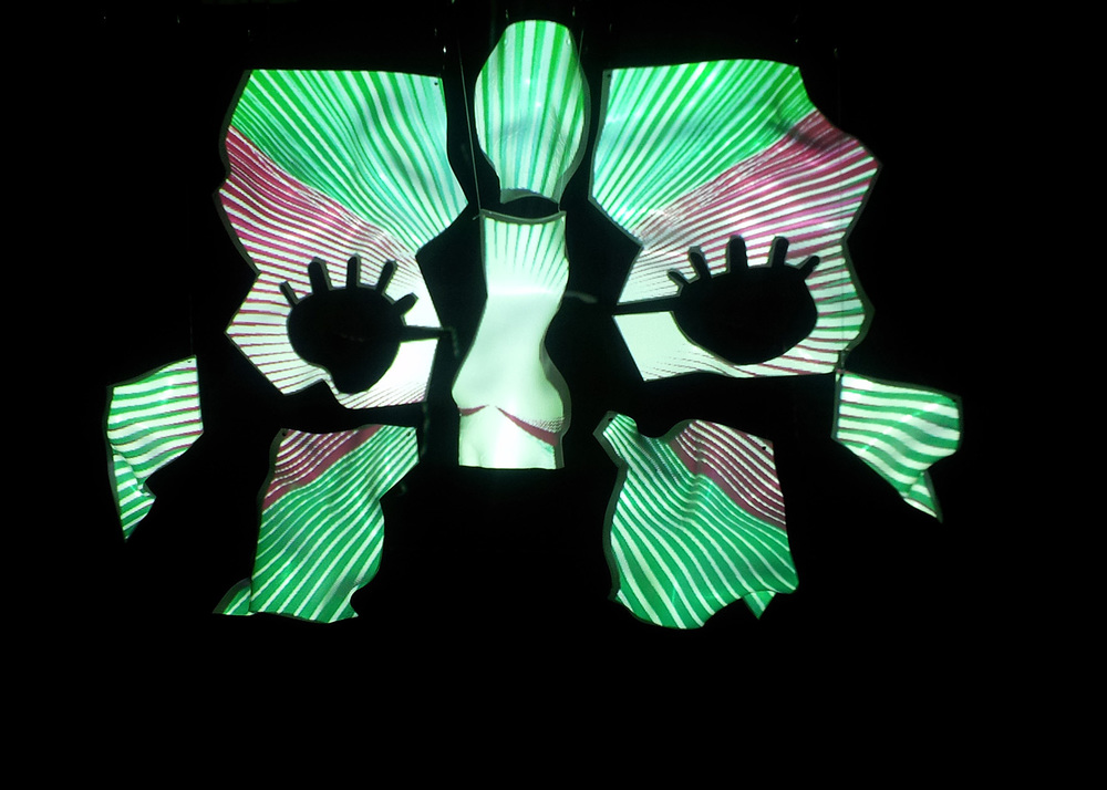 Video mapping on specially designed perspex pieces, 2012.