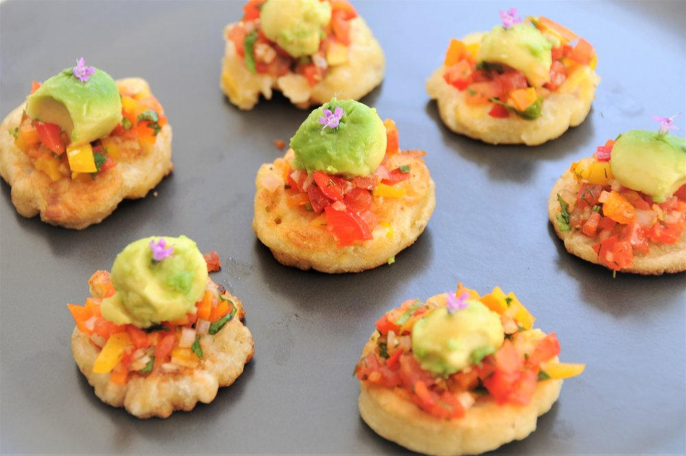 Spiced corn cakes, cumin and coriander salsa with avocado ball and thyme flower