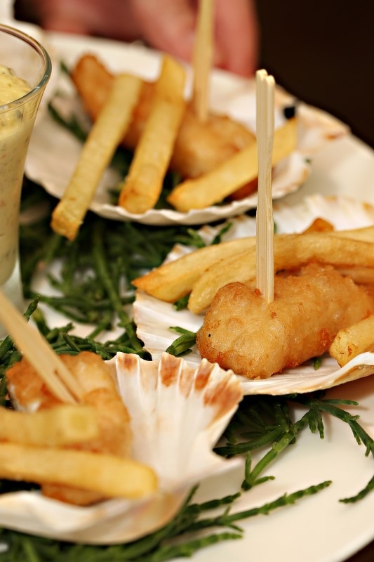Tempura of sole served on a scallop shell served with pomme frites, samphire and tartare sauce