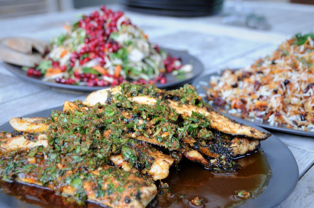 Chermoula sea bass, pomegranate slaw, Persian rice
