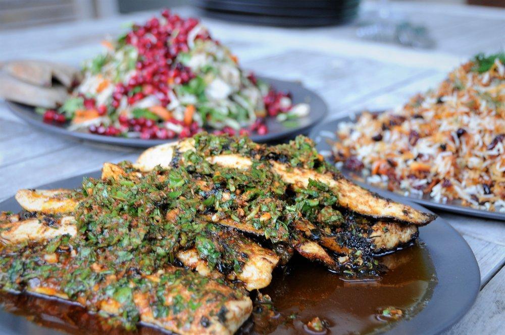 Chermoula sea bass, pomegranate slaw, Persian rice