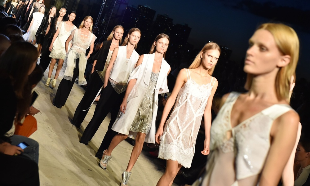 Models wear lace slips on the catwalk for the Givenchy show.Photograph: WWD/REX Shutterstock