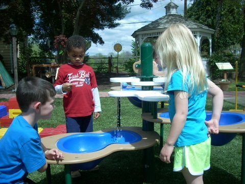 The water table allows for fun play during the warm weather