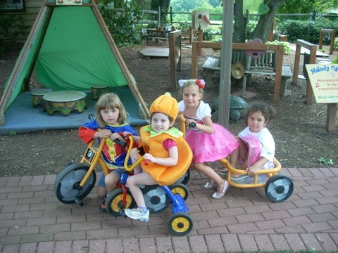 Children ride trikes at one of the four playgrounds