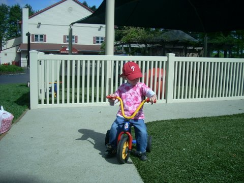 Riding a trike on the soft playground service