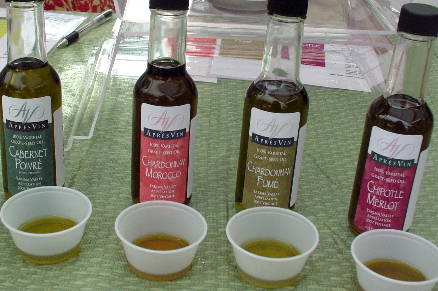 Just a sampling of the grapeseed oil flavors offer by Apres Vin at Wallingford Farmers Market. Photo copyright 2009 by Zachary D. Lyons.