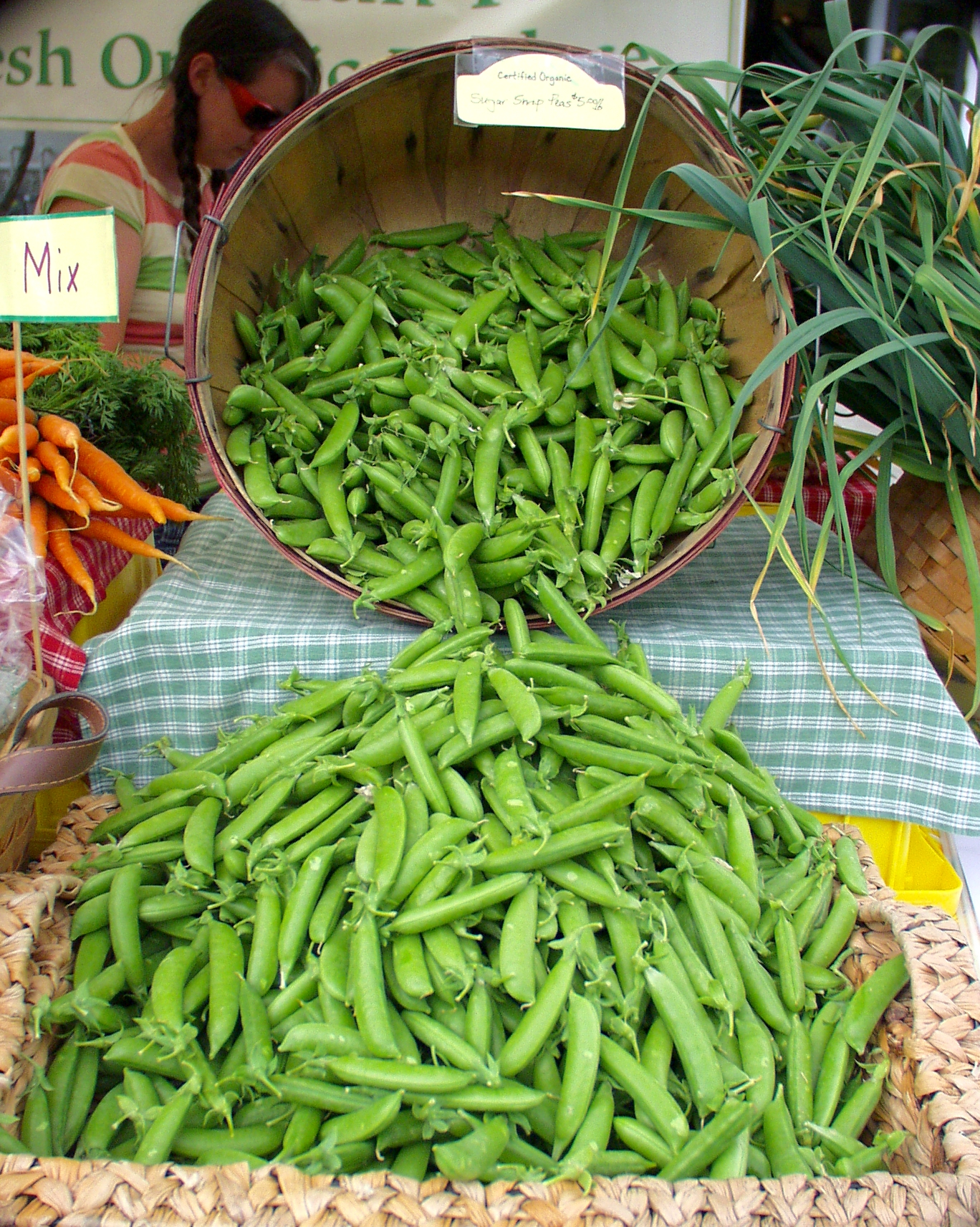 Summer Run's pea display looks as if they are just waiting to pour into your shopping bag for the trip home. Photo copyright 2009 by Zachary D. Lyons.
