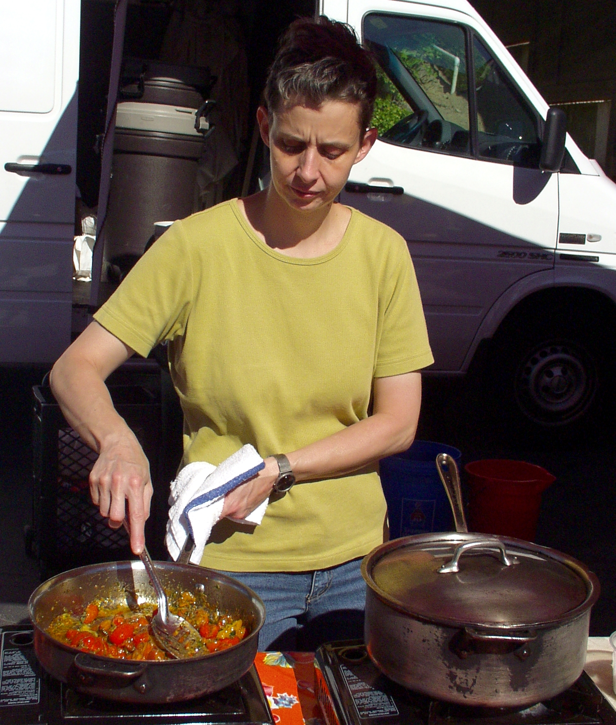Chef Amy McCray of Eva Restaurant sautés tomatoes for her chutney on July 1st. Photo copyright 2009 by Zachary D. Lyons.