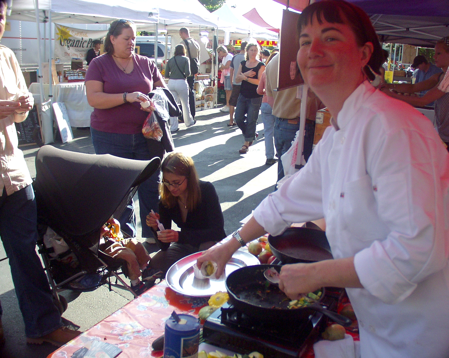 Chef Sara Moot, from Persimmon, performing a cooking demonstration at Wallingford Farmers Market in 2008. Photo copyright 2008 by Zachary D. Lyons.