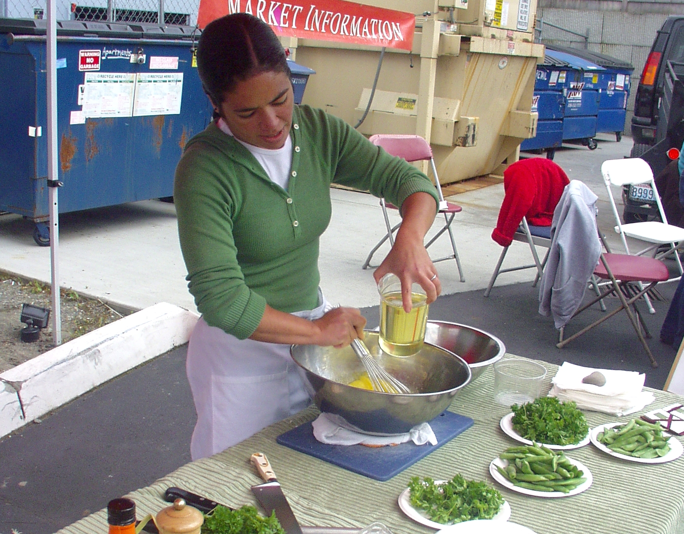 Chef Maria Hines of Tilth Restaurant performing a cooking demonstration at Wallingford Farmers Market in 2008. Photo copyright 2008 by Zachary D. Lyons.