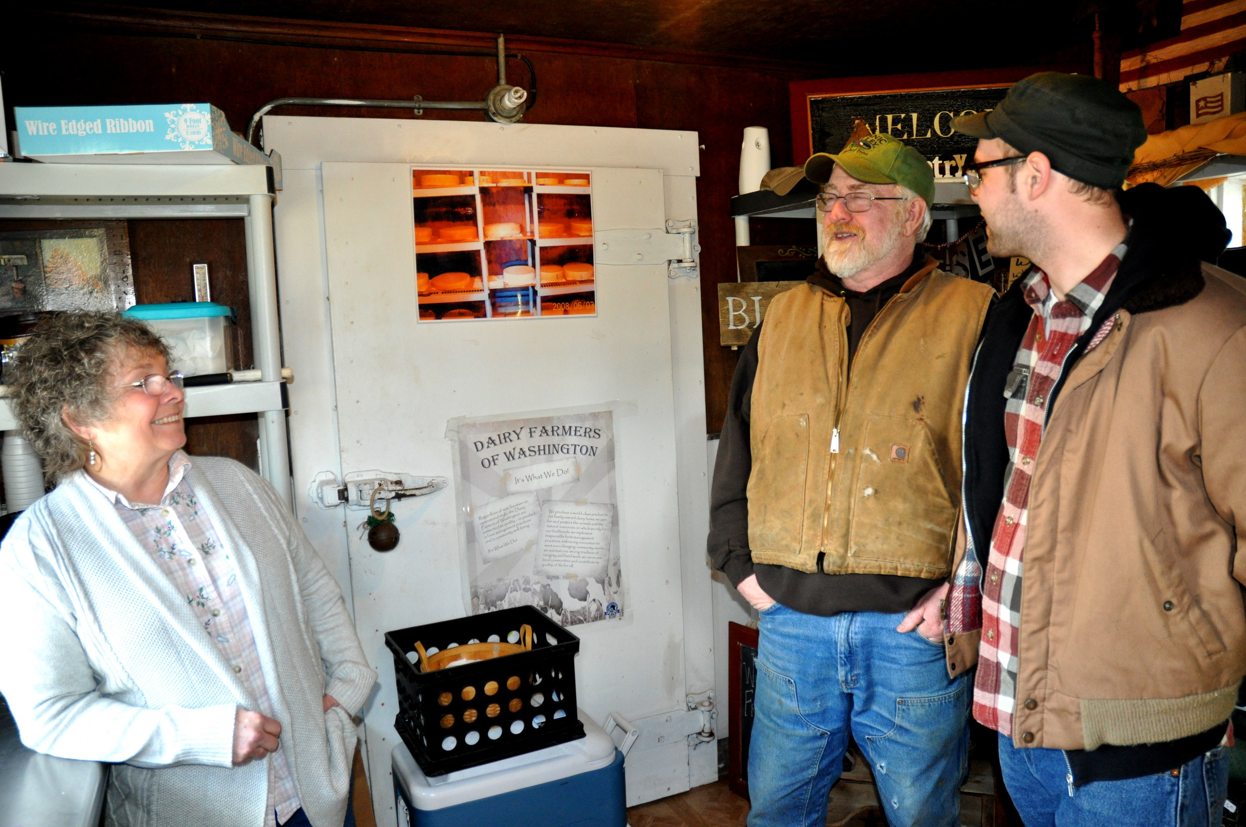 Sharon (left) & Gary McCool (center) chat with our own Gil Youenes at Rosecrest Farm. Photo copyright 2013 by Zachary D. Lyons.