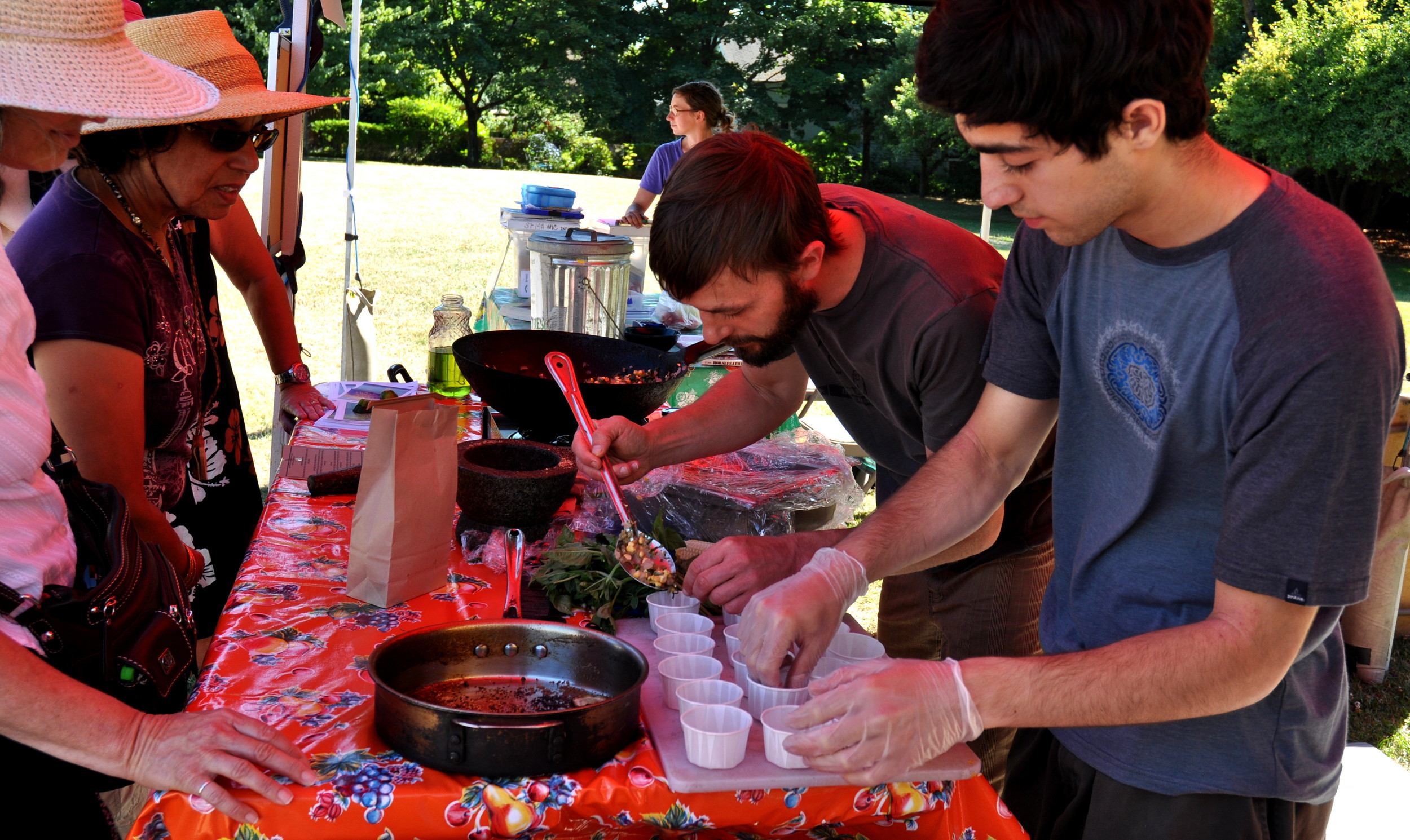 Chef Colin Patterson of Sutra Vegetarian Cuisine (center) and Jeremy Kaplan (right, foreground) at their cooking demonstration in 2011. Photo copyright 2011 by Zachary D. Lyons.