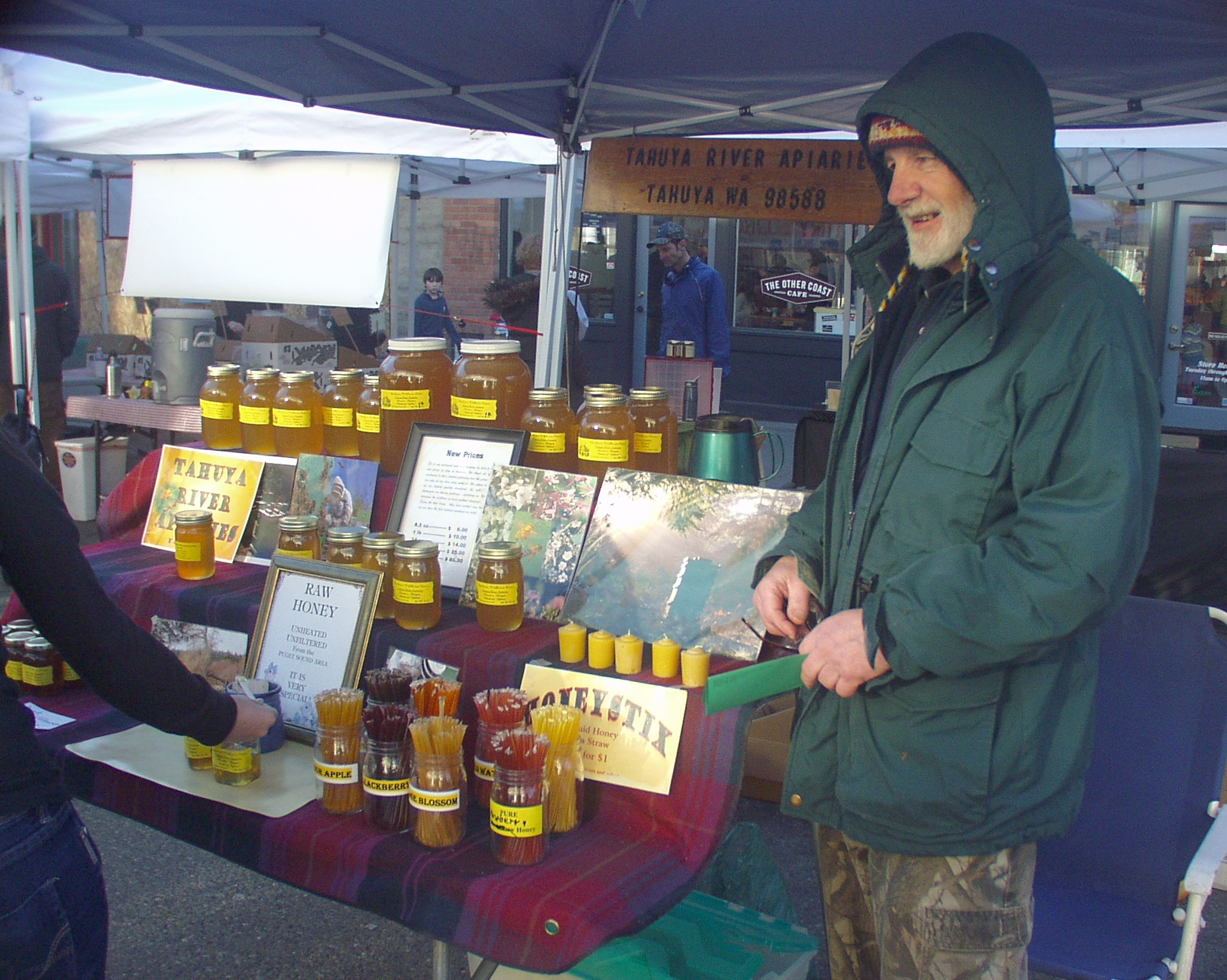 Roy Nettlebeck, owner of Tahuya River Apiaries, at the market in January 2009.  Photo copyright 2009 by Zachary D. Lyons