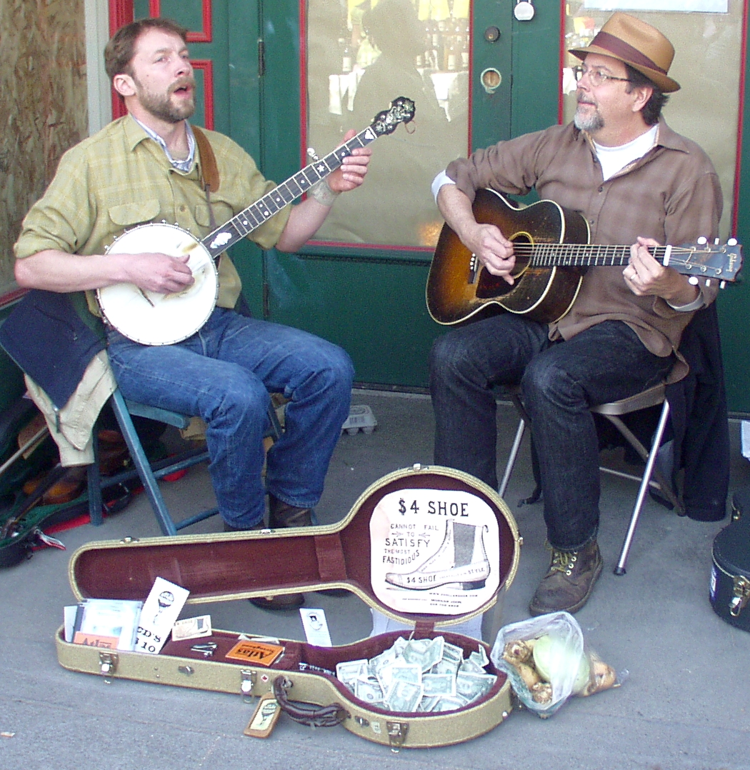 Morgan John, left, and Tom Collicott of the Atlas String Band performing at Ballard Farmers Market on April 5, 2009. Photo copyright 2009 by Zachary D. Lyons.