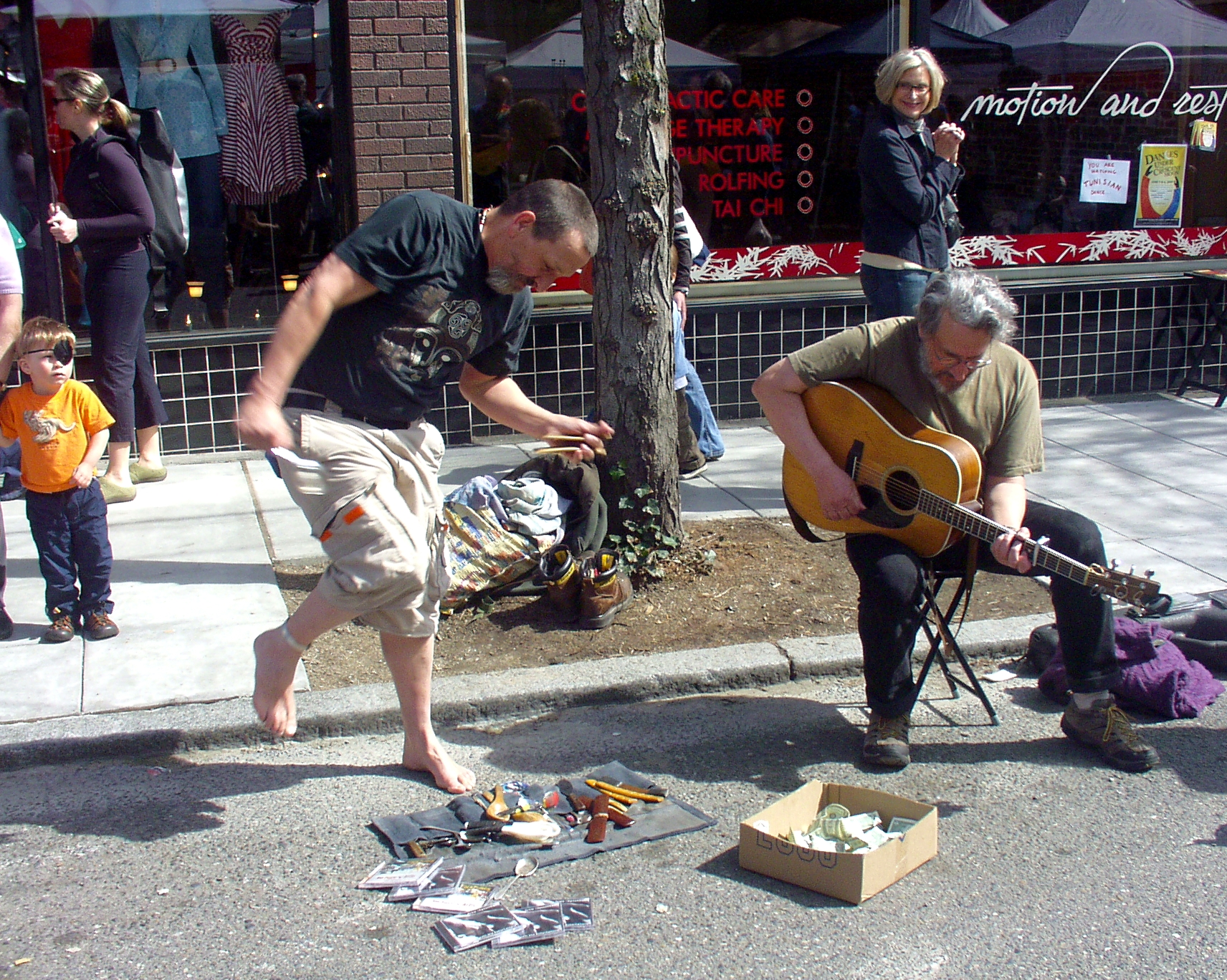 Artis The Spoonman & Jim Page led an all-star cast of buskers filling every nook and cranny of Ballard Avenue. Photo copyright 2009 by Zachary D. Lyons.