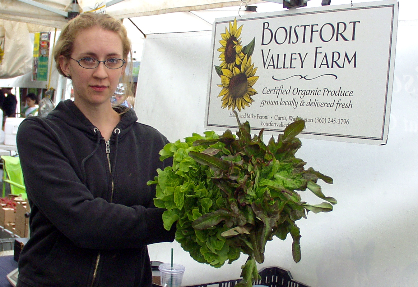 Valerie Rose of Boistfort Valley Farm holds up some of their beautiful Red Oakleaf and Salad Bowl lettuce. Photo copyright 2009 by Zachary D. Lyons.