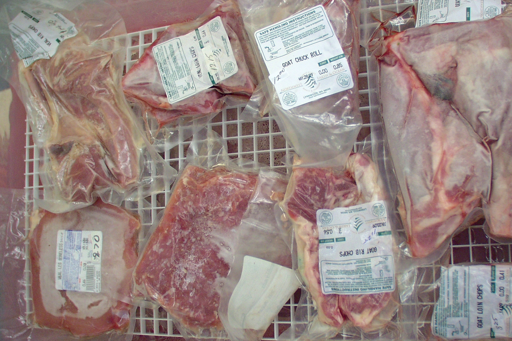Quilceda Farm's goat meat display at the Market. Photo copyright 2009 by Zachary D. Lyons.