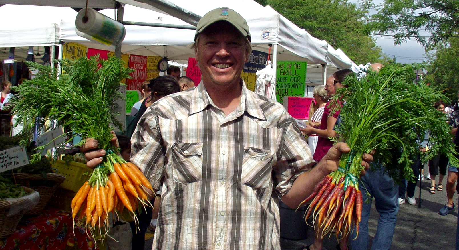 Oxbow Farm's Luke Woodward proudly showing off his prized carrots. Photo copyright 2009 by Zachary D. Lyons.