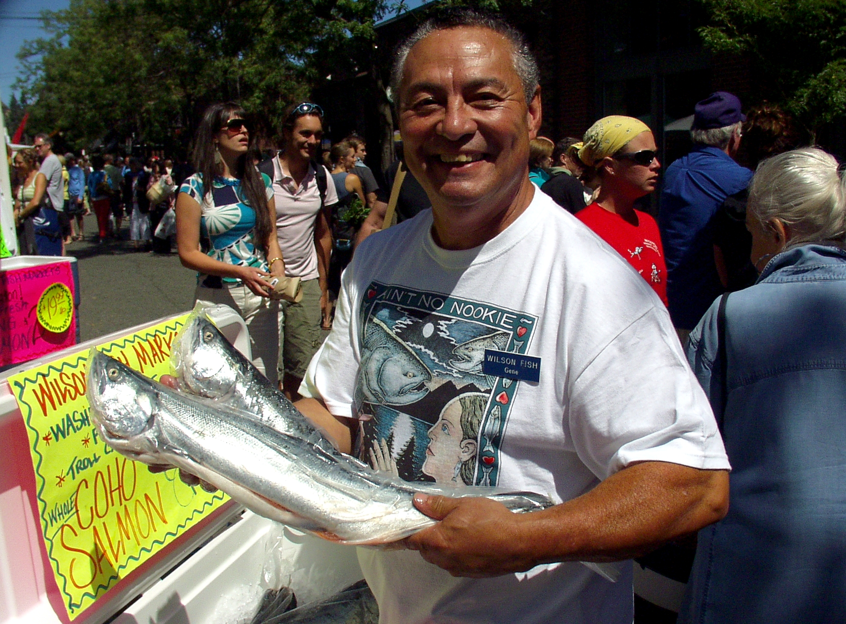 "Gene Panida of Wilson Fish proudly showing of his ""Bag-O-Fish."" Photo copyright 2009 by Zachary D. Lyons."