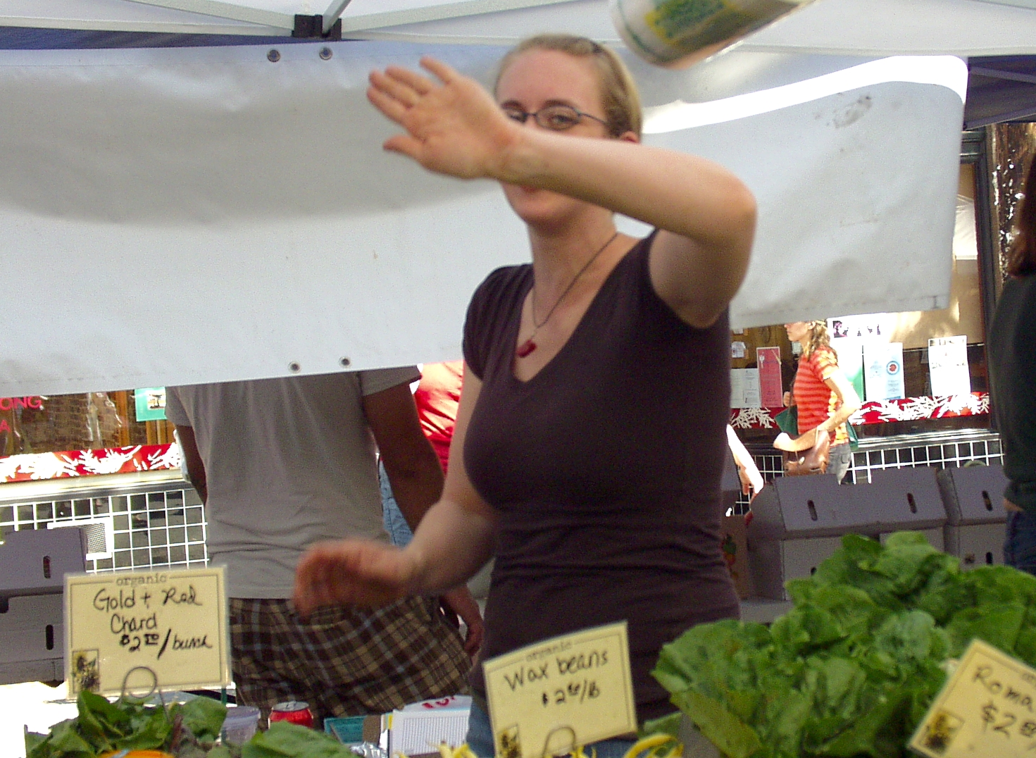 Valerie from Boistfort Valley Farm waves off the Market paparazzi. Photo copyright 2009 by Zachary D. Lyons.