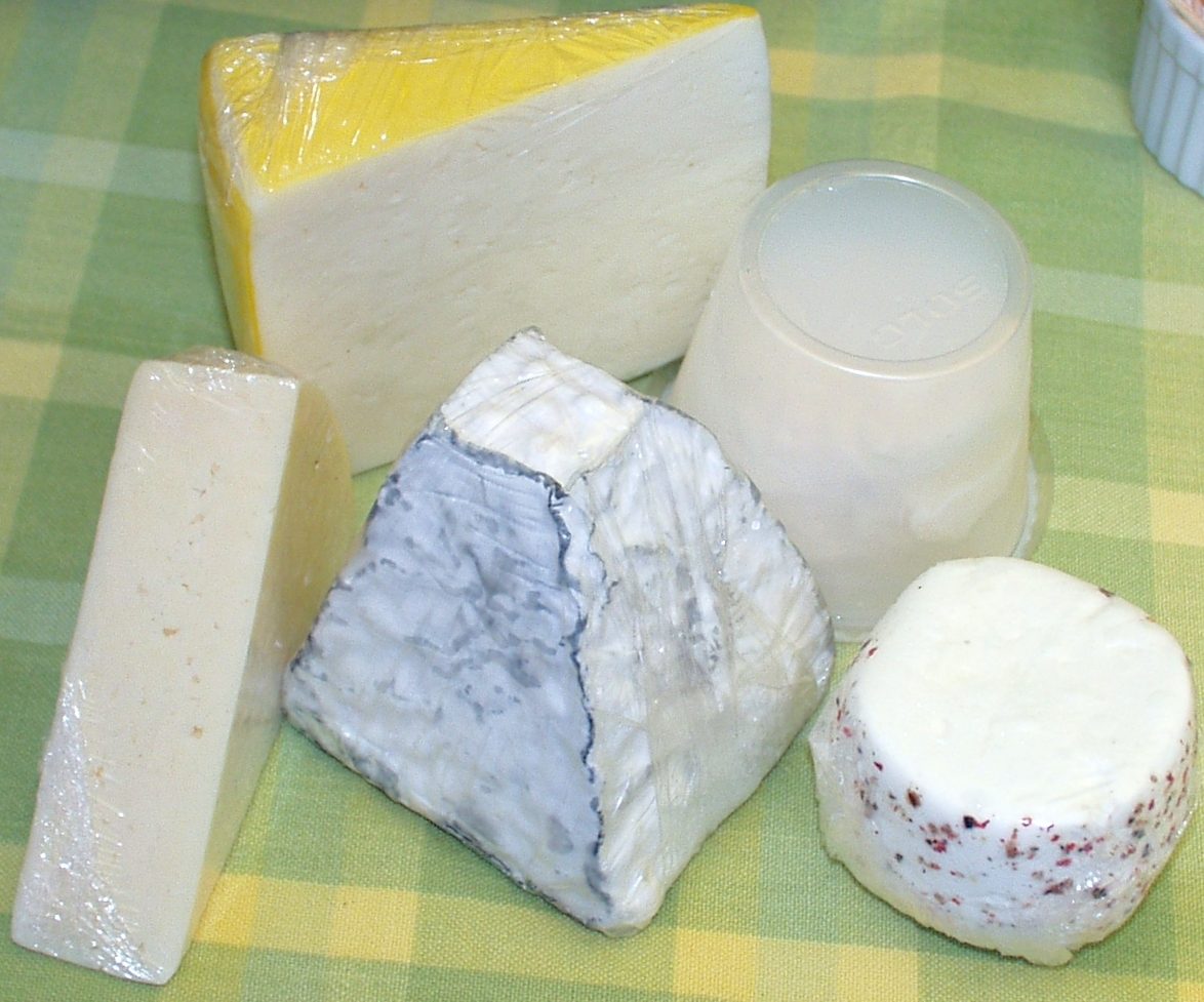 Clockwise from lower left corner, spring cheese, farmhouse cheddar, crottin, peppered chevre and Mt. St. Helens from Port Madison. Photo copyright 2009 by Zachary D. Lyons.
