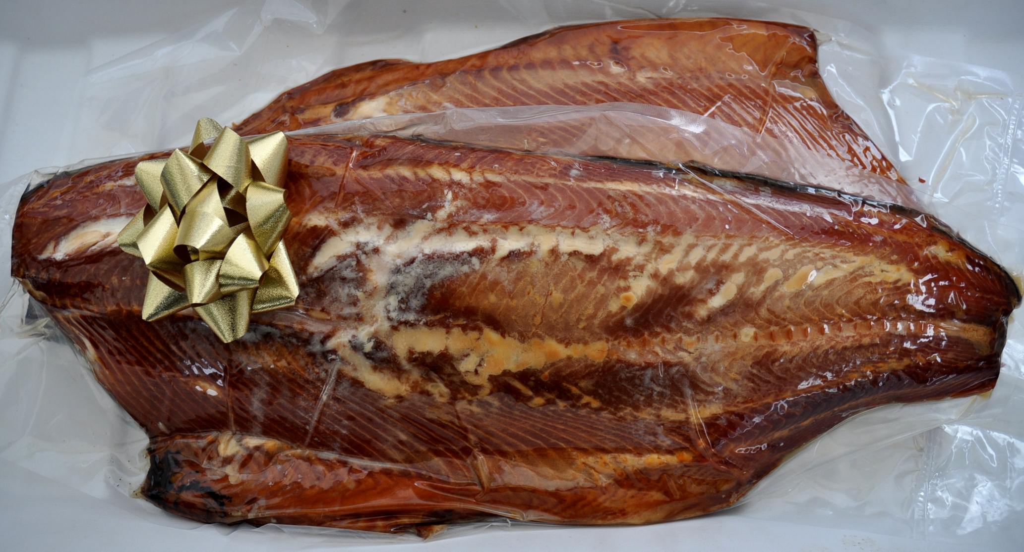 Smoked whole sides of white king salmon from Wilson Fish. Photo copyright 2010 by Zachary D. Lyons.